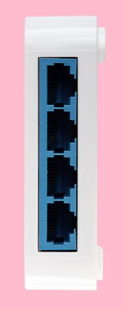 White 8 Port Plastic Ethernet Switch isolated on pink background at dry day 写真素材