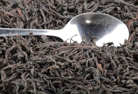 black tea and teaspoon background