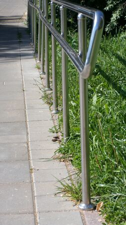 metal fence in park at dry sunny summer day Imagens