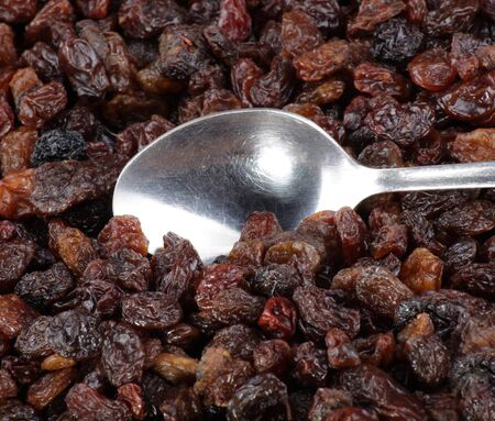 many raisin background and teaspoon