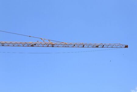 boom of crane tower on sky