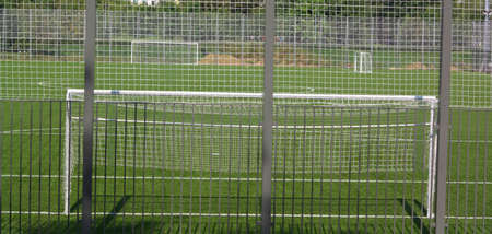 football field near fence at day sunny day Standard-Bild