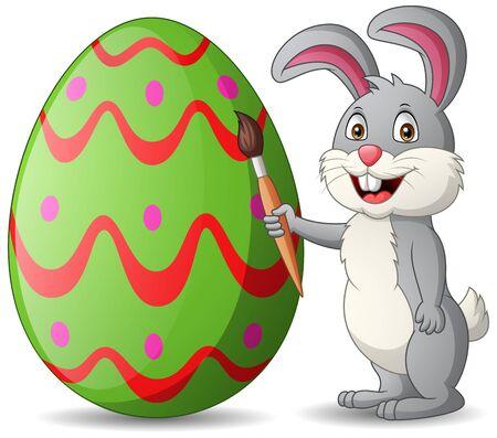 Cartoon rabbit is painting eggs. Illustration Stockfoto