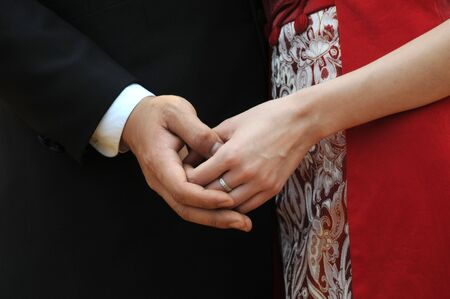 ring stand: Close up on couples hands