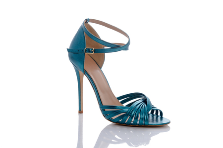clasp feet: beautiful turquoise color sandals for summer glossy Stock Photo