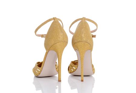 clasp feet: an amazing yellow shiny shoes for women