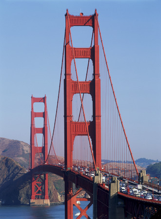 A Close Up Of The San Francisco Golden Gate Bridge Filled With Traffic Seen In Late Afternoon Sun