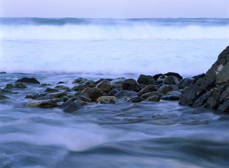 Wave Wash Up On An Oregon Coastline LANG_EVOIMAGES