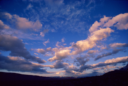 A Horizontal Distorted Photograph Of A Cloudy Sky