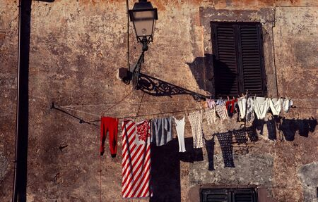 Laundry Hangs On A Line Near A European City Wall At Sunset LANG_EVOIMAGES