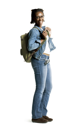 Profile Of A Happy Young Black Woman Carrying A Backpack LANG_EVOIMAGES