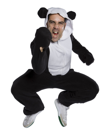 Portrait Of A Mid Adult Man Dressed In A Bear Costume