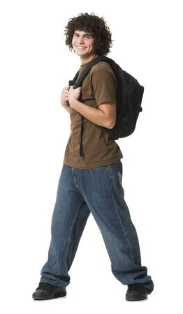 Portrait Of A Teenage Boy Carrying A Bag And Smiling