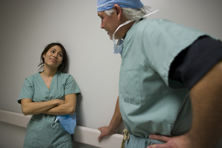 registered nurse: Close-Up Of A Male And Female Surgeon Talking