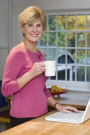 Portrait Of A Mature Woman Holding A Coffee Cup LANG_EVOIMAGES