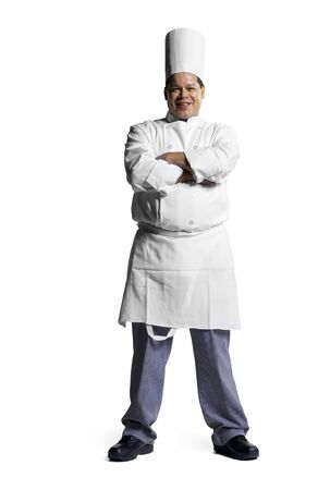 culinary arts: Portrait Of A Male Chef Standing With His Arms Folded