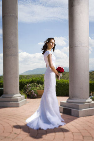 Profile Of A Young Modern Bride Holding A Bunch Of Flowers
