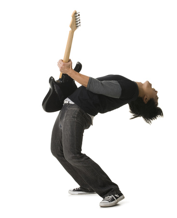 Young Man Playing An Electric Guitar LANG_EVOIMAGES