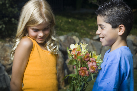 Profile Of A Boy Giving Flowers To A Girl And Smiling