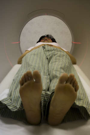 Close-Up Of A WomanS Fet As Cat Scan Is Performed