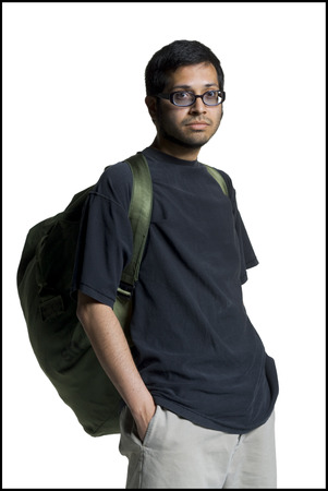 Portrait Of A Young Man Carrying A Backpack With His Hands In His Pockets