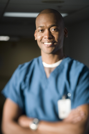 caregivers: Portrait Of A Male Doctor Smiling With His Arms Crossed