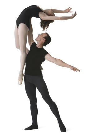 Male Ballet Dancer Lifting A Female Ballerina
