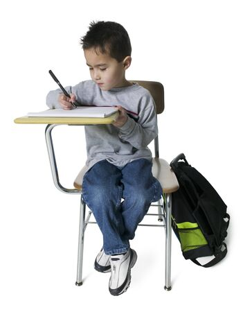 Boy Writing On A Note Pad