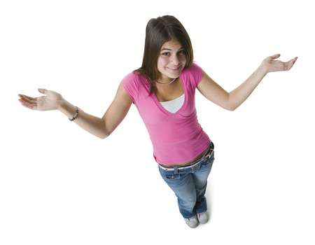 High Angle View Of A Teenage Girl Standing With Her Arms Raised And Smiling