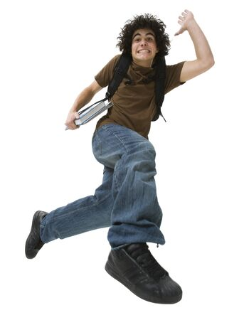 Portrait Of A Teenage Boy Making A Face And Jumping In Mid-Air LANG_EVOIMAGES