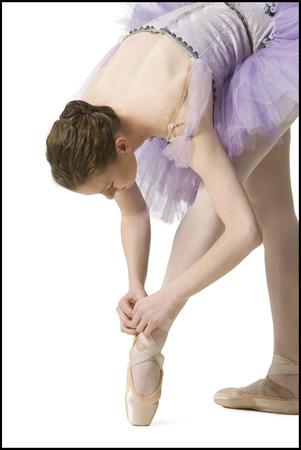 Ballerina Tying Her Slipper