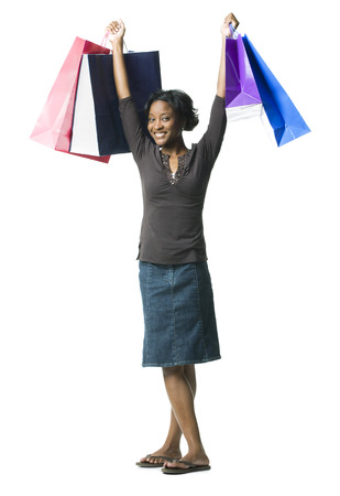 customer facing: Portrait Of A Young Woman Holding Shopping Bags