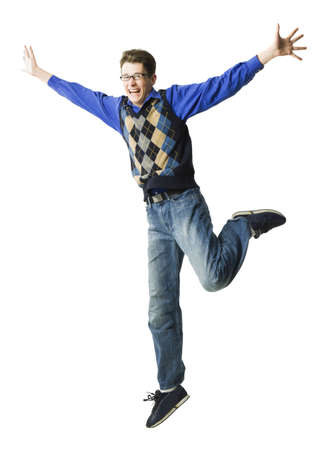 caucasian appearance: Portrait Of A Young Man Jumping With His Arms Outstretched LANG_EVOIMAGES