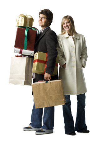 customer facing: Portrait Of A Young Woman And A Young Man Carrying Gifts And Shopping Bags