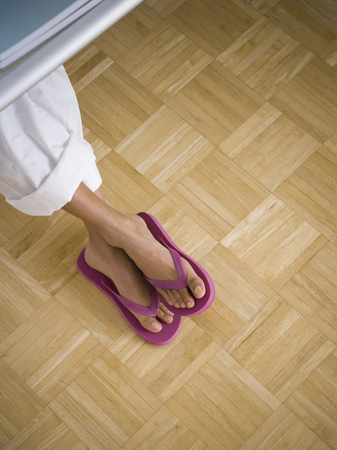 flip flops: High Angle View Of A WomanS Legs Crossed LANG_EVOIMAGES