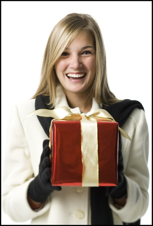 generosa: Portrait Of A Young Woman Holding A Gift And Smiling LANG_EVOIMAGES