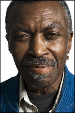 skepticism: Portrait Of A Mature Black Man Smiling LANG_EVOIMAGES