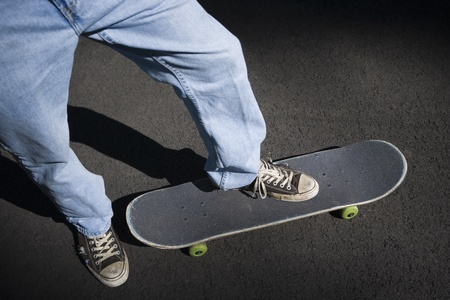 Low Section View Of A Person Skateboarding