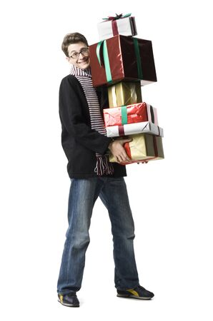 Portrait Of A Young Man Holding A Stack Of Gifts