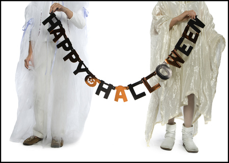 stage props: Boy And A Girl Holding A Halloween Banner LANG_EVOIMAGES
