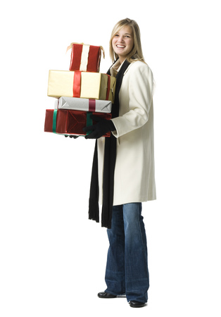 customer facing: Portrait Of A Young Woman Holding Gifts LANG_EVOIMAGES