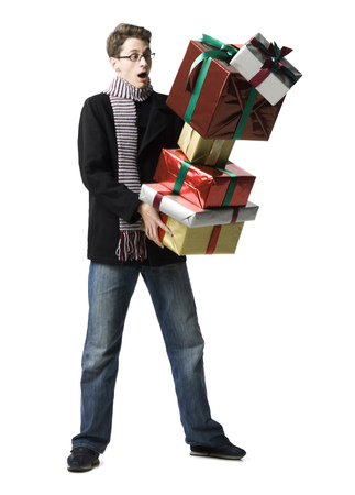 Young Man Holding A Stack Of Gifts