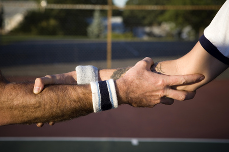 introductions: Close-Up Of Two Tennis Players Shaking Hands
