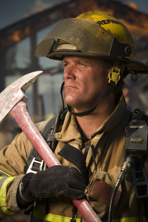 Close-Up Of A Firefighter Holding An Axe