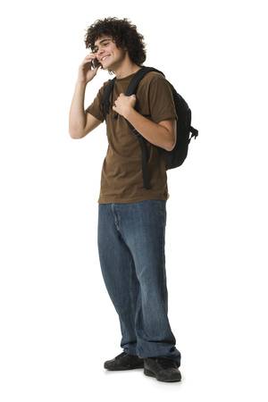 Teenage Boy Using A Phone And Smiling
