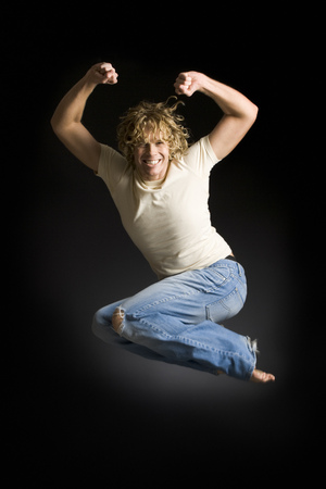 Portrait Of A Young Man Jumping