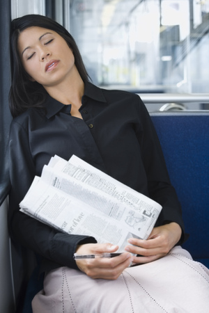 Close-Up Of A Woman Sleeping On A Commuter Train