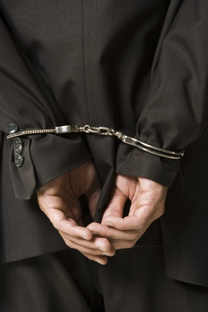 restraints: Rear View Of A Businessman In Handcuffs