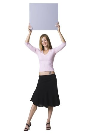 Portrait Of A Young Woman Lifting Up A Blank Sign