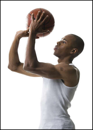 Portrait Of A Young Man Shooting A Basketball